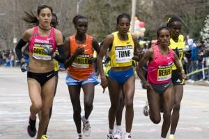 Boston, Ma 04 20 2009 the Elite Women race as a bunch up Heartbreak Hill during the Boston Marathon