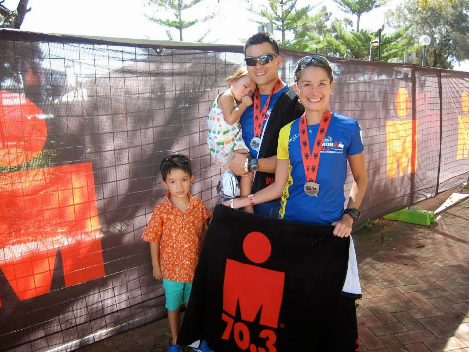 Our first 70.3 Ironman for my husband and I in Mandurah, Western Australia (11/2013). The kids were trying very hard to smile! This was no sub-1hr event and it was 38 degrees celcius that day!