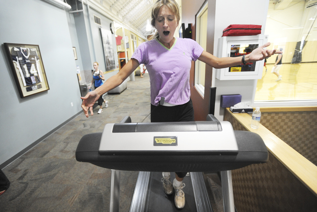 """NICK WOLCOTT/CHRONICLE Margaret Kohler sings opera while running on a treadmill at the Ridge Athletic Club on Wednesday to promote Intermountain Opera's """"Bravo!"""" at the Willson Auditorium this Friday and Sunday."""