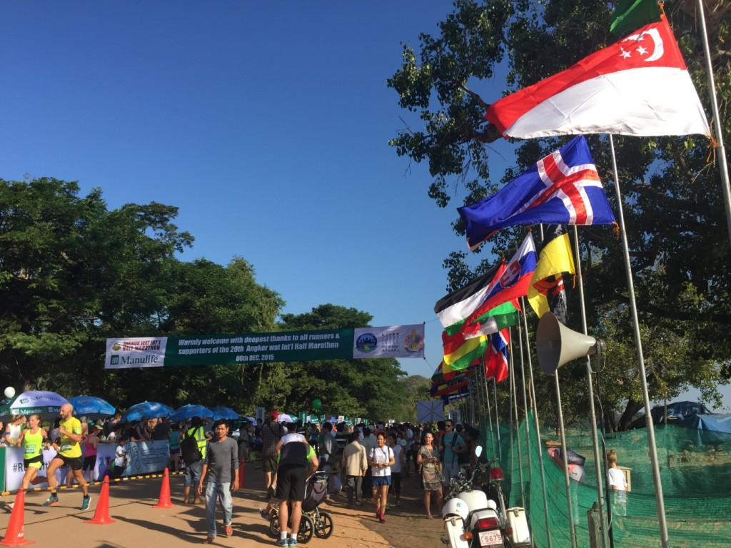 Flags from all participating nations line the finishing path