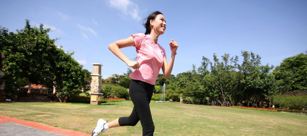 woman running outdoors training at park
