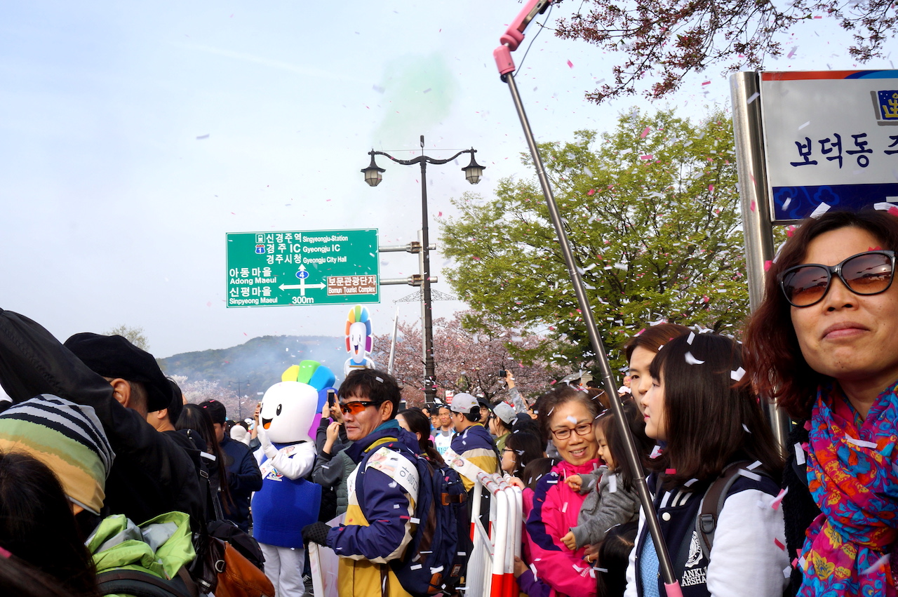 Supporters at race start at Gyeongju Cherry Blossom Marathon 2016