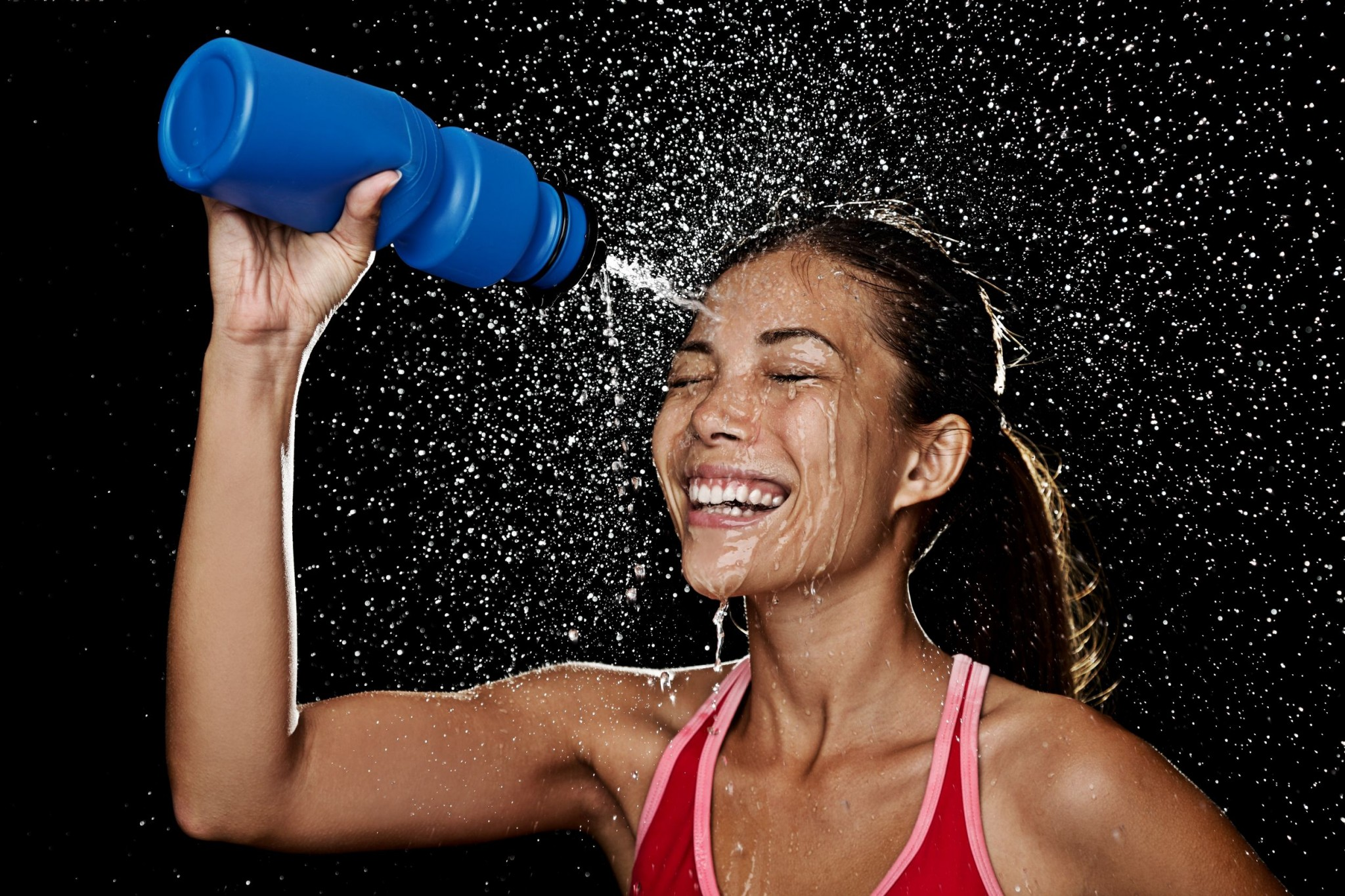 runner splashing water in her face