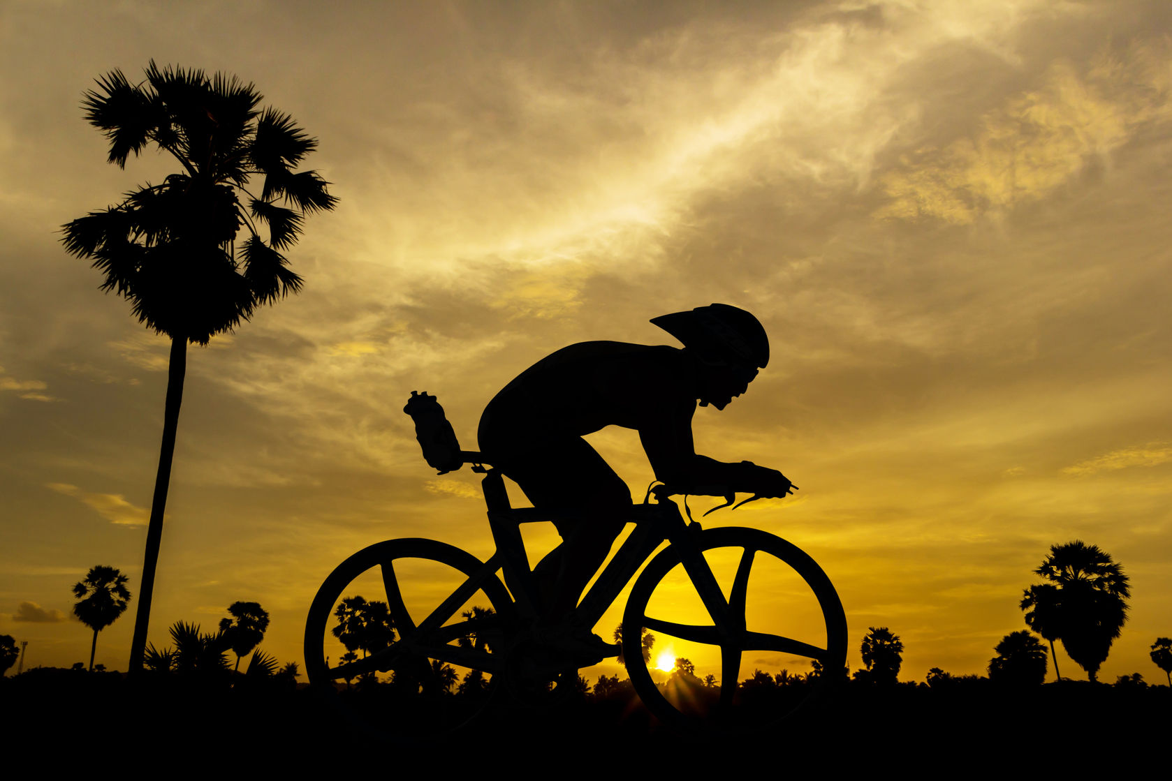 cycling-on-sunset-time-in-thailand-asia