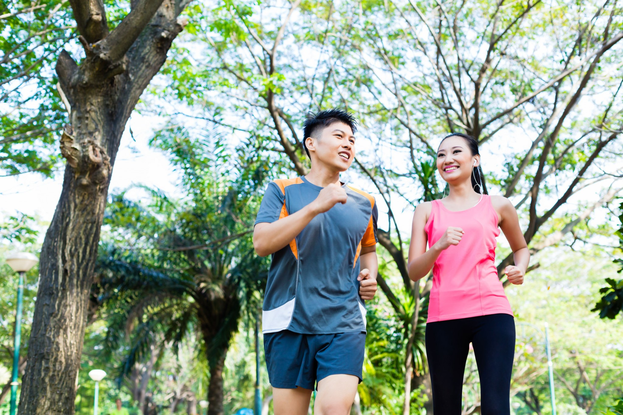 asian-chinese-man-and-woman-jogging-in-city-park-exercise