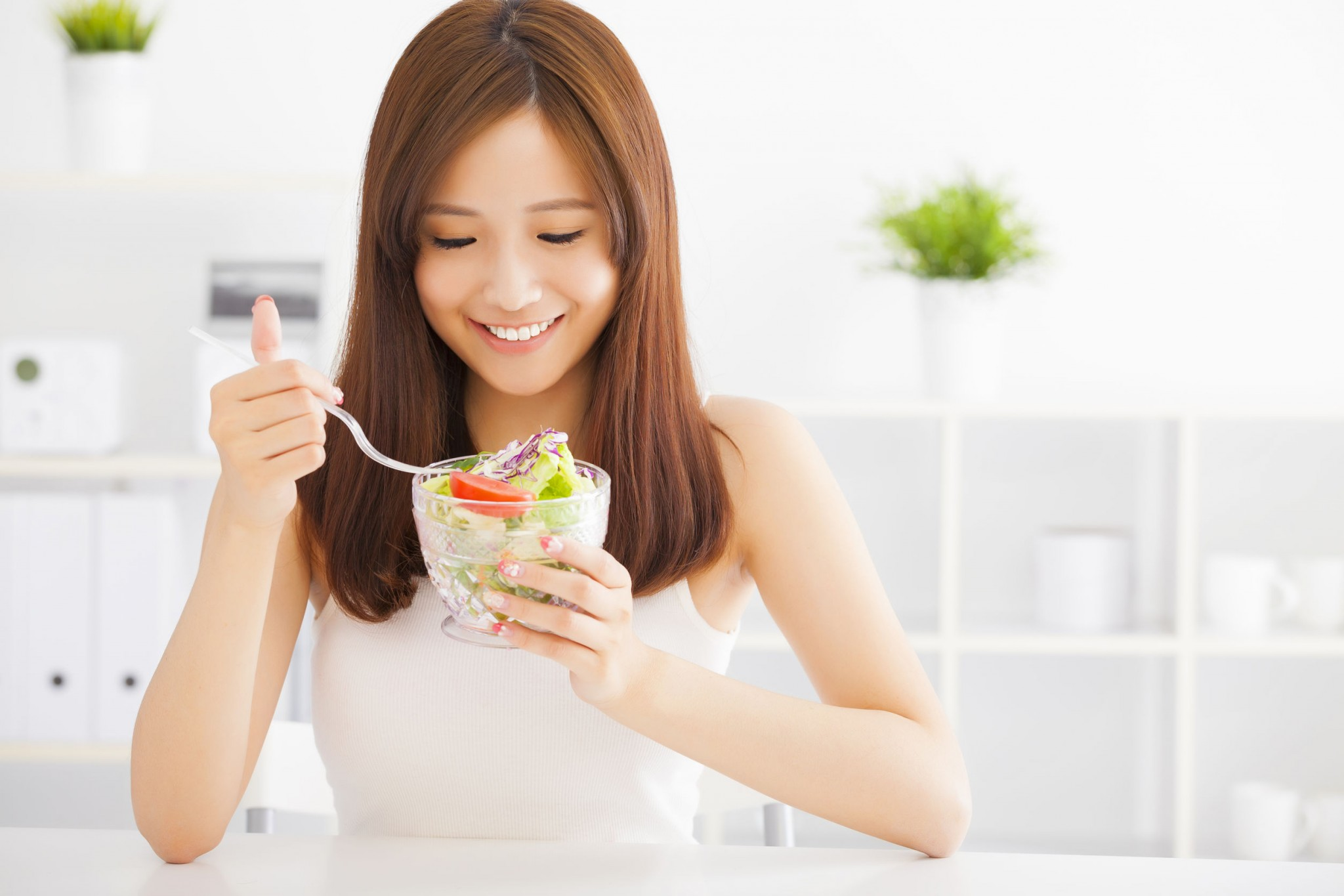 asian-young-woman-eating-healthy-food