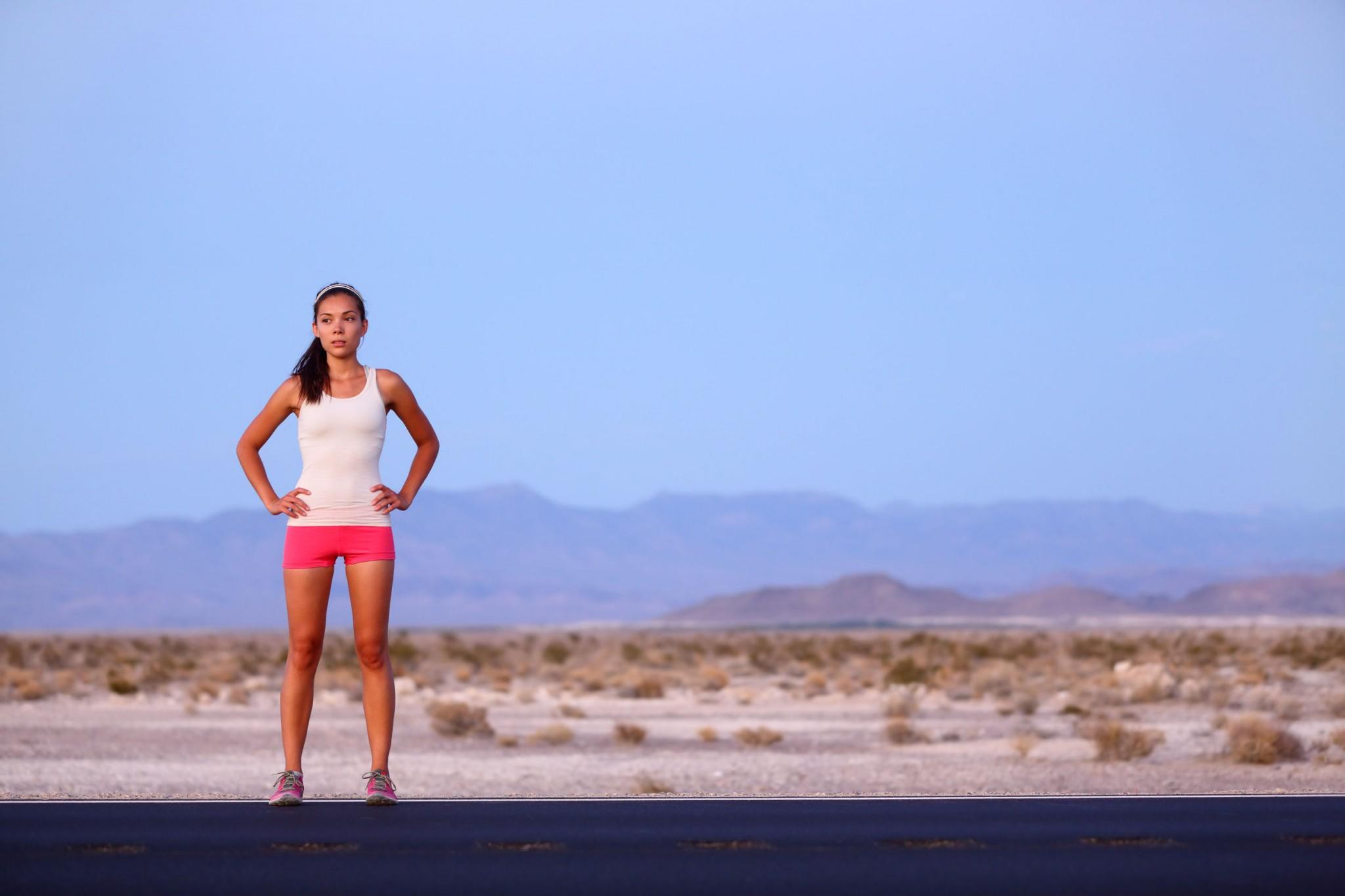 female-runner-resting-road