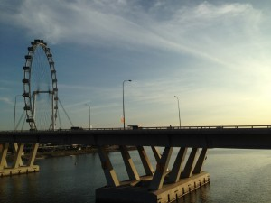 Beautiful play of colors in the morning with the Singapore flyer, Sheares Bridge and the morning sun and cloud