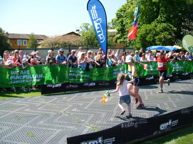 Crossing the finish line of the Edinburgh Marathon with her six year old niece, Caoilfhionn.