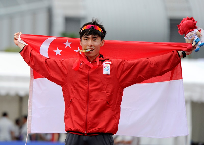 28th SEA Games Singapore 2015 - East Coast Park, Singapore - 7/6/15 Athletics - Men's Marathon - Singapore's Guillaume Soh Rui Yong celebrates winning the marathon SEAGAMES28 TEAMSINGAPORE Mandatory Credit: Singapore SEA Games Organising Committee / Action Images via Reuters