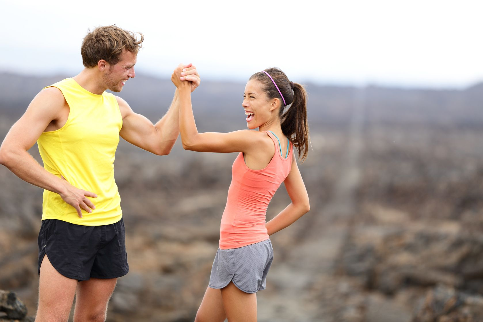 Young fitness couple celebrating
