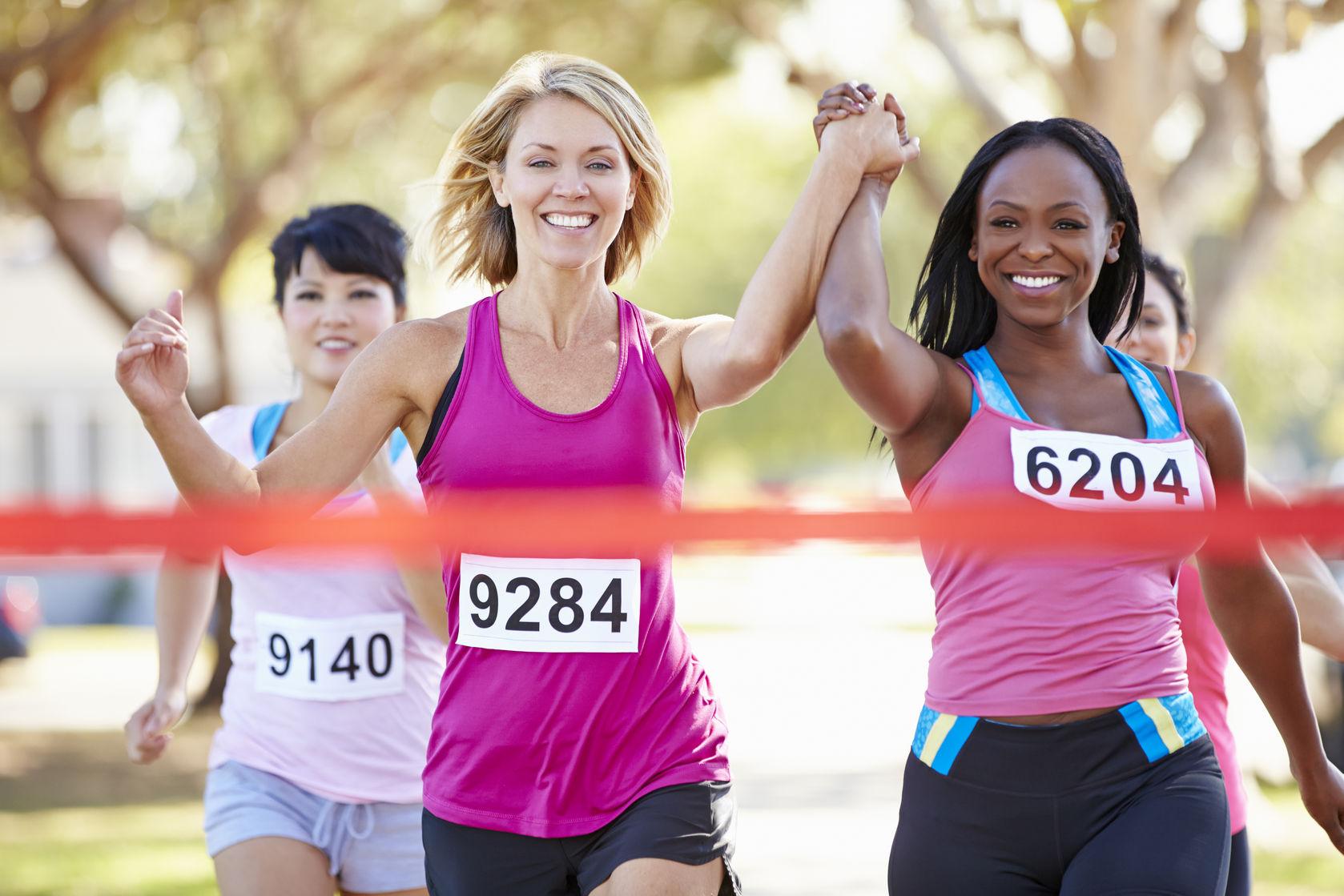 Young women racing towards finish line