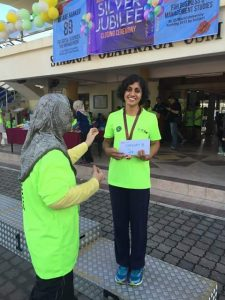 The author winning third place in the Women's Open Category of the super-hilly Universiti Sains Malaysia Fun Run 2015.