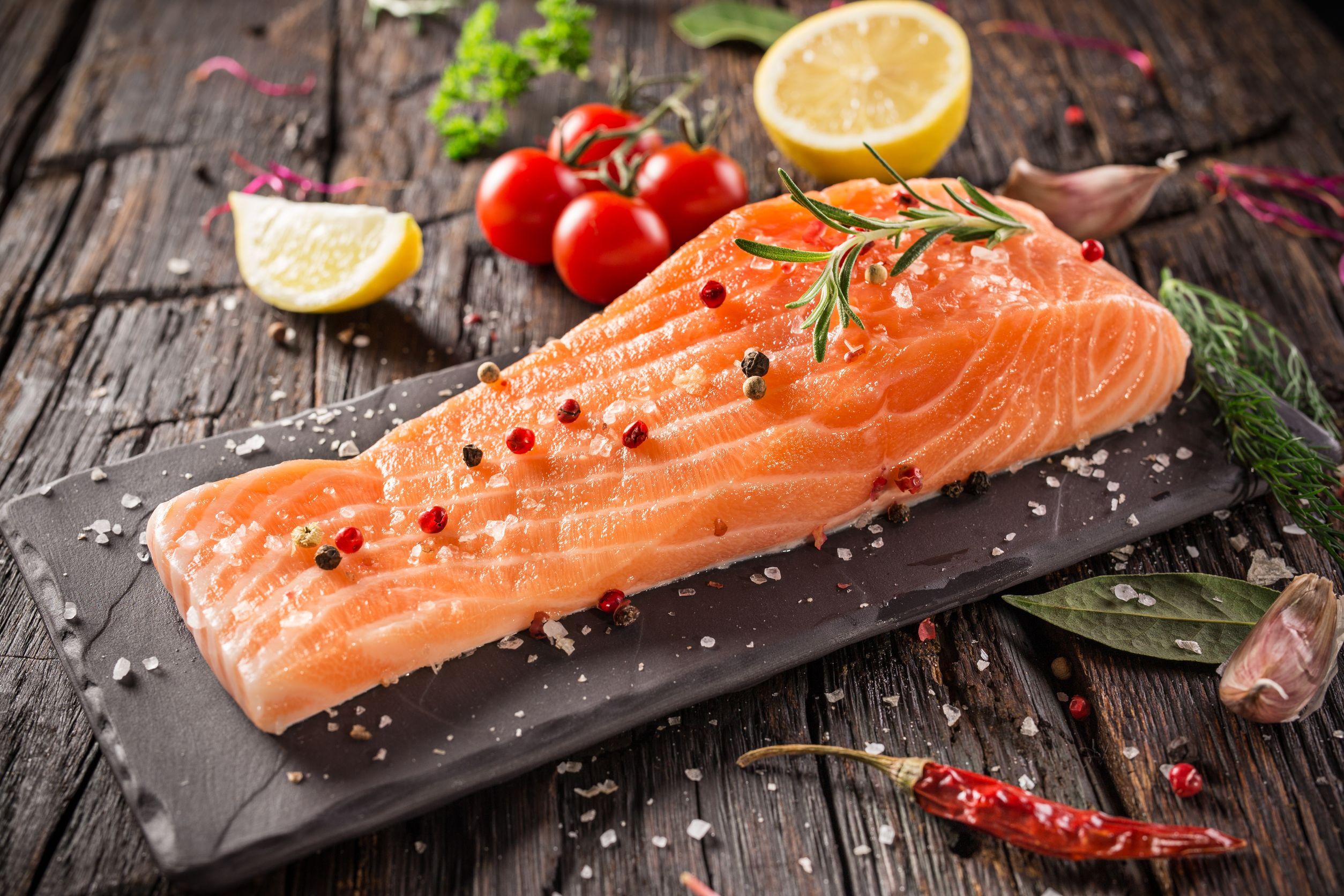 salmon-steak-on-wooden-table